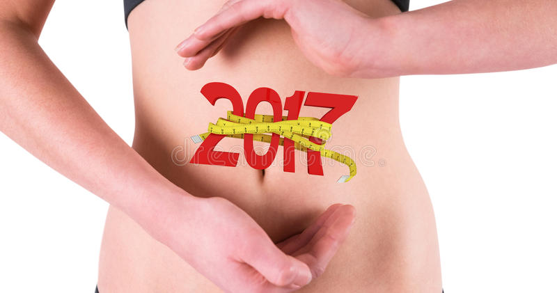 Composite image of woman with hands over belly stock image