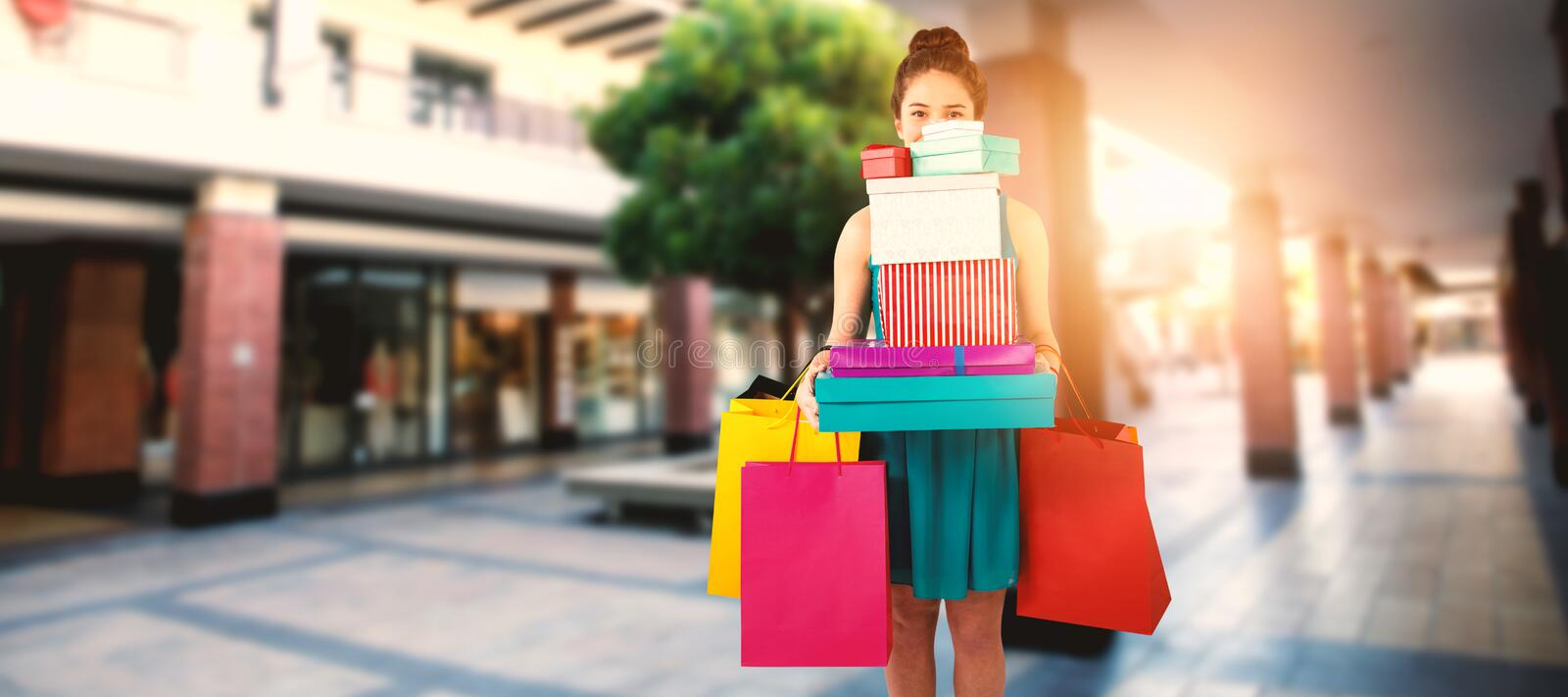 Composite image of women holding shopping bag royalty free stock images