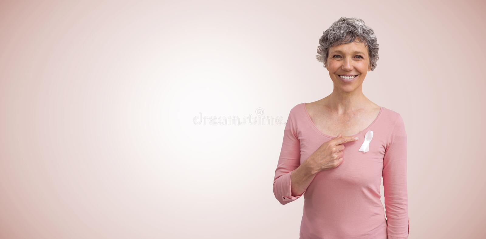 Composite image of woman in pink outfits showing ribbon for breast cancer awareness stock photos
