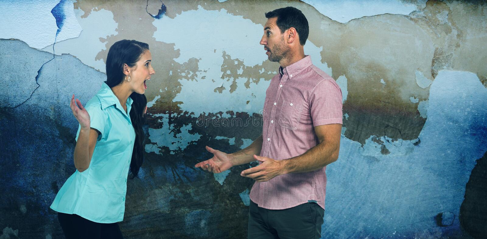 Composite image of woman shouting on man while fighting stock image