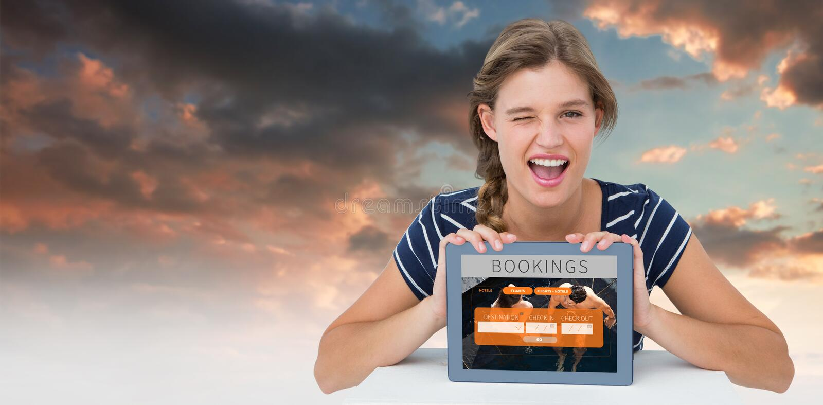 Composite image of woman showing tablet pc royalty free stock photos