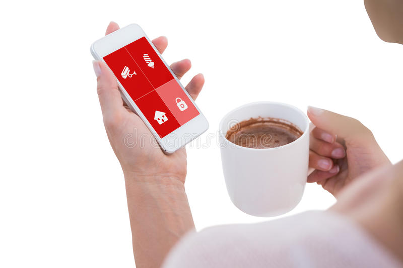Composite image of woman using her smartphone royalty free stock photo