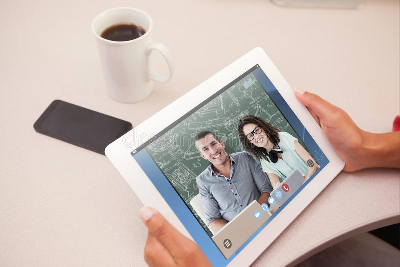 Composite image of woman using tablet pc stock photo