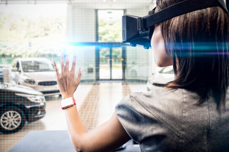 Composite image of woman using a virtual reality device. Woman using a virtual reality device against view of row new car royalty free stock photos