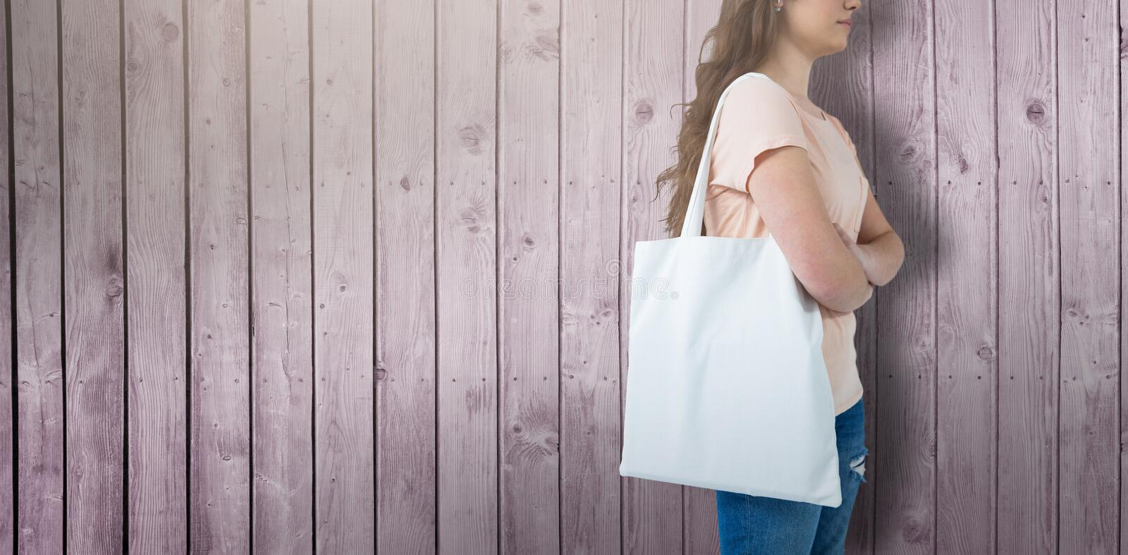 Composite image of women holding bag with blank space stock images