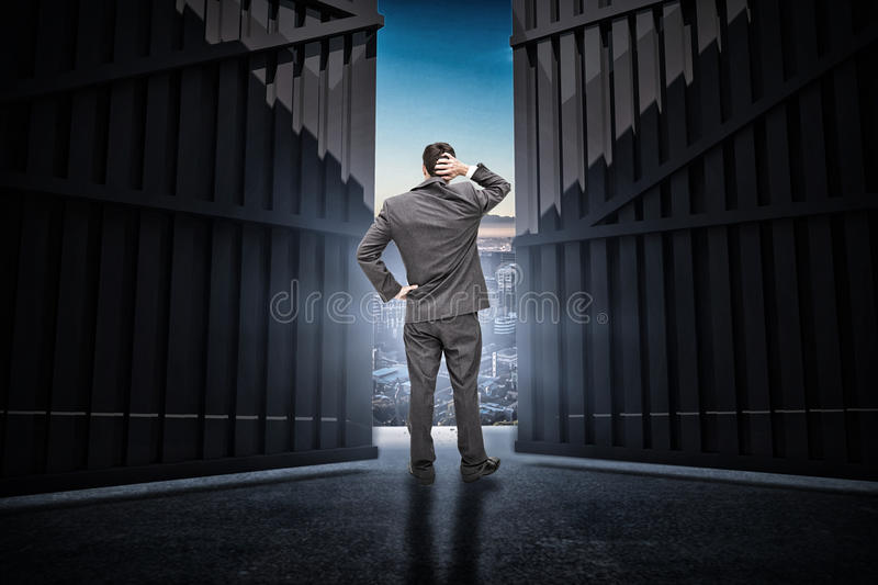 Composite image of young businessman standing back to camera scratching his head 3d stock images
