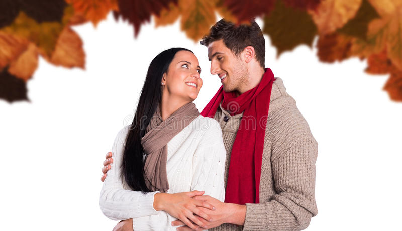 Composite image of young couple smiling and hugging royalty free stock photos