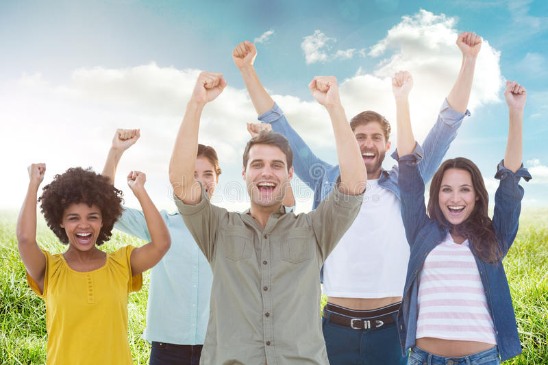 Composite image of young creative business people gesturing arm up. Young creative business people gesturing arm up against sunny landscape stock photos