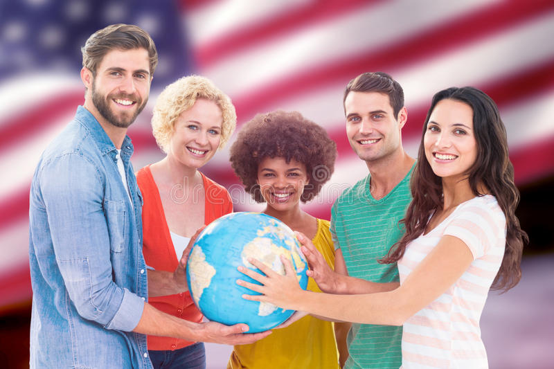 Composite image of young creative business people with a globe. Young creative business people with a globe against composite image of digitally generated united stock image