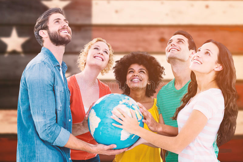 Composite image of young creative business people with a globe. Young creative business people with a globe against composite image of usa national flag stock image