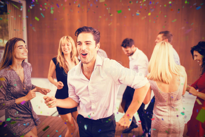 Composite image of young friends having fun at party stock photos