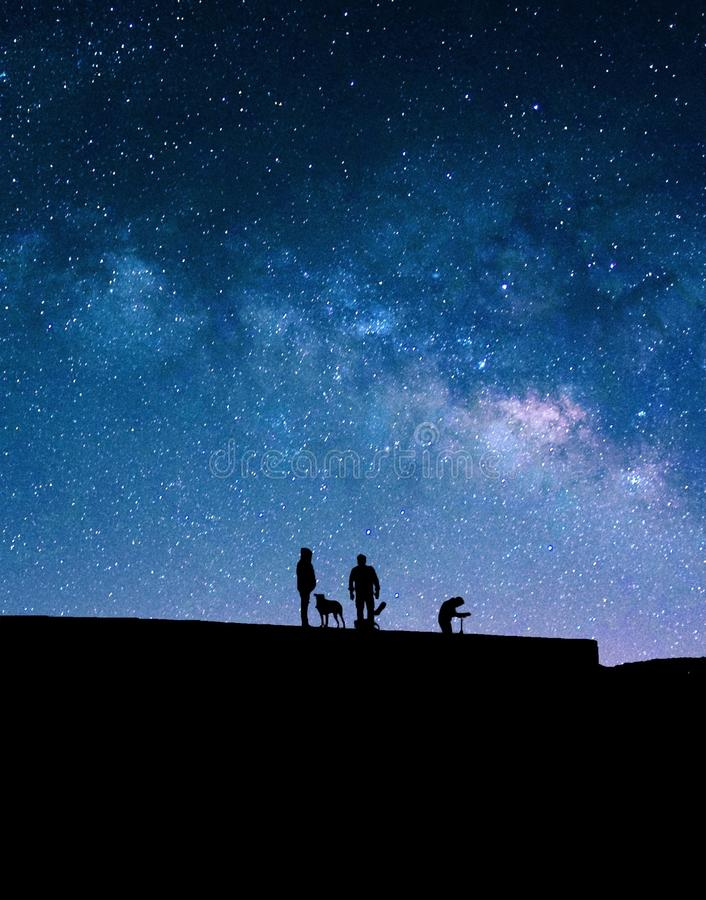 Milky Way and silhouettes of people. royalty free stock photo