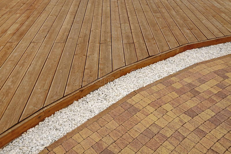 Composite Wood Decking, White Marble Gravel And Stone Brick Paving stock photography