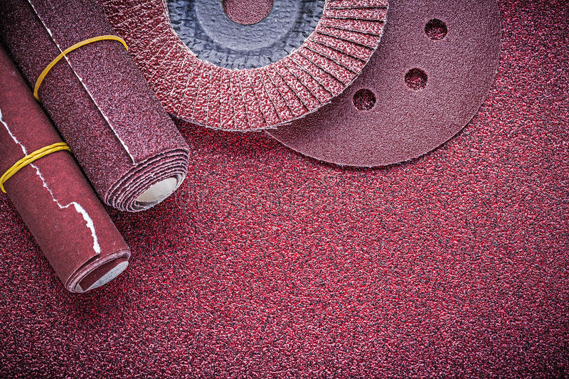 Composition of abrasive flap wheels grinding discs sandpaper rol. Ls stock images