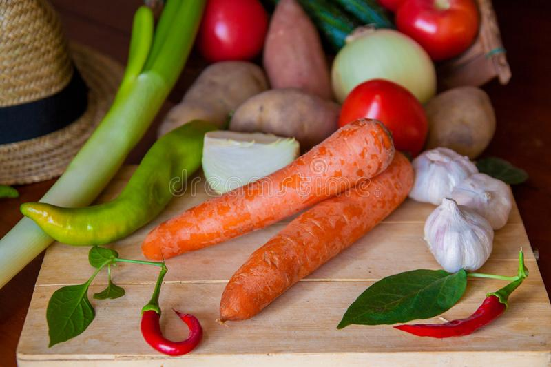 Composition with assorted raw organic vegetables. Detox diet, garlic and peppers. stock photo