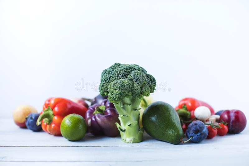 Composition with assorted raw organic vegetables on a wooden background. stock image