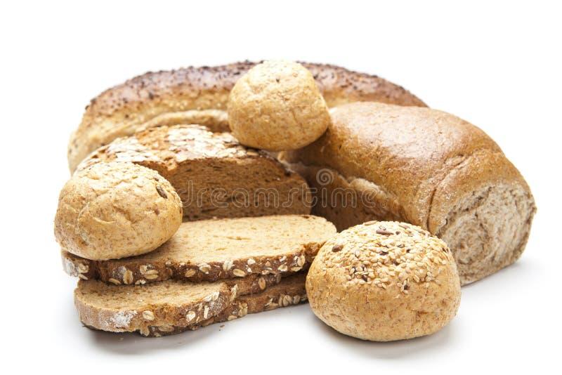 Composition avec du pain et des roulis d'isolement sur le blanc image libre de droits