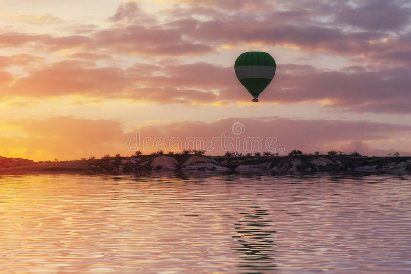 Composition of balloons over water and valleys, gorges, hills, b royalty free stock photos