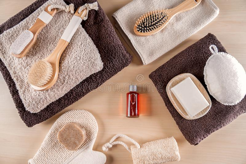 Composition with bathroom amenities on wooden background royalty free stock photo