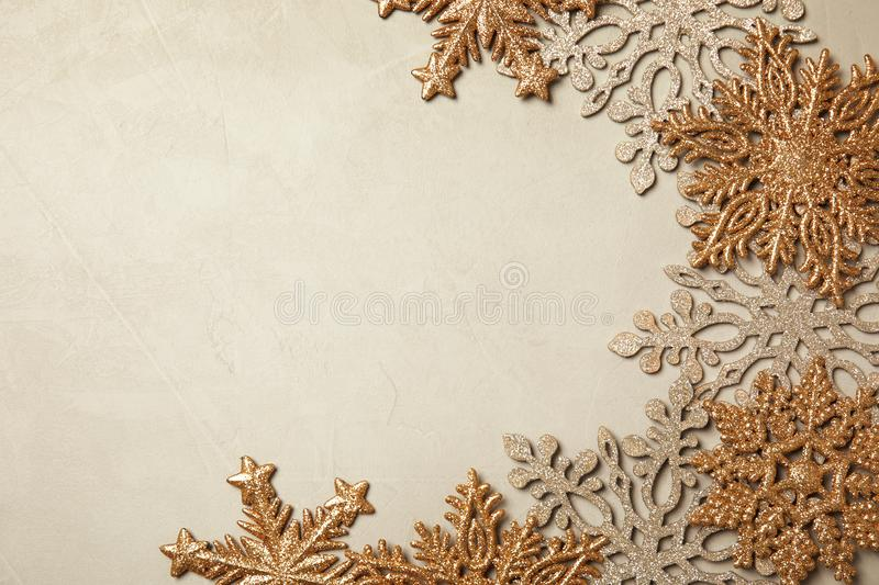 Composition with beautiful snowflakes and space for text on color background, top view stock photos