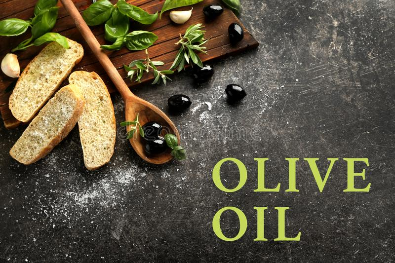 Composition with black olives, spices and bread on dark background royalty free stock images