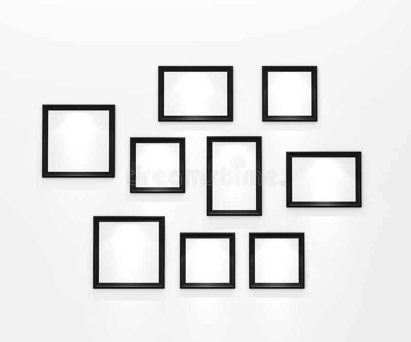Composition of blank black picture frames on white wall with spotlight royalty free illustration
