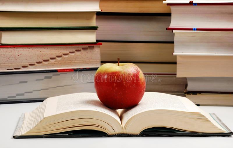 Composition with books and apple royalty free stock photography