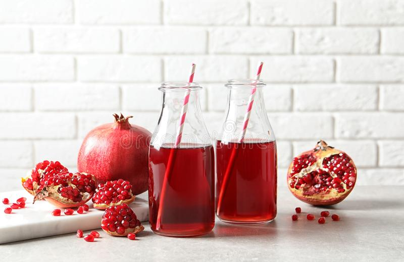 Composition with bottles of fresh pomegranate juice stock photo