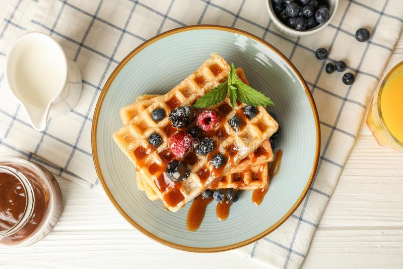 Composition of breakfast with belgian waffles stock photography
