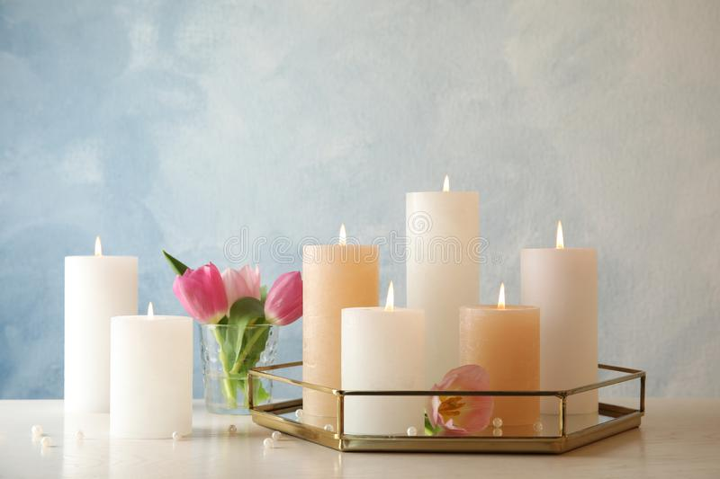 Composition with burning candles on table stock image