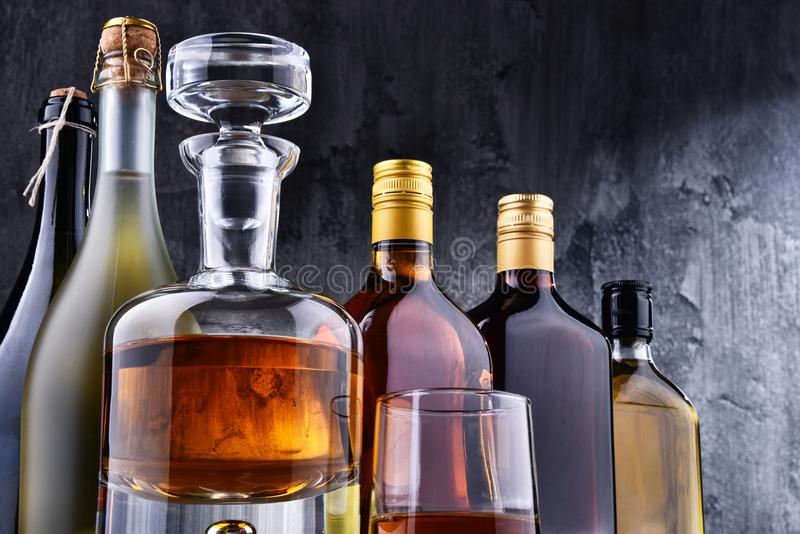 Carafe and bottles of assorted alcoholic beverages. Composition with carafe and bottles of assorted alcoholic beverages royalty free stock images