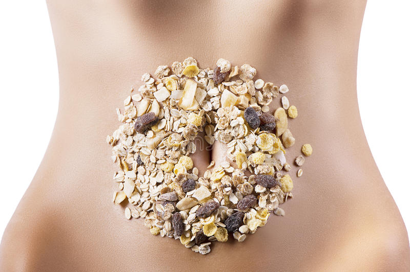 Composition of cereals and dried fruits over belly stock photo