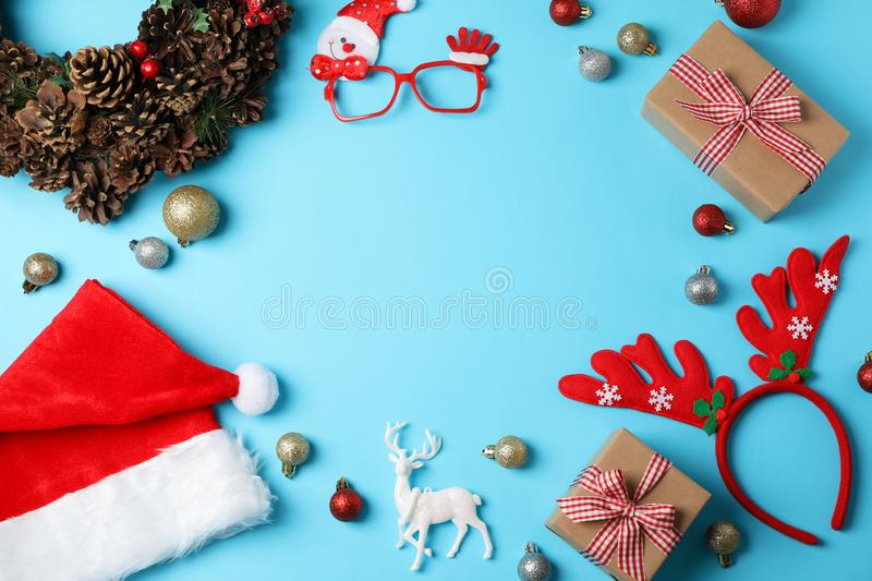 Composition with Christmas baubles on blue background. Space for text stock photos