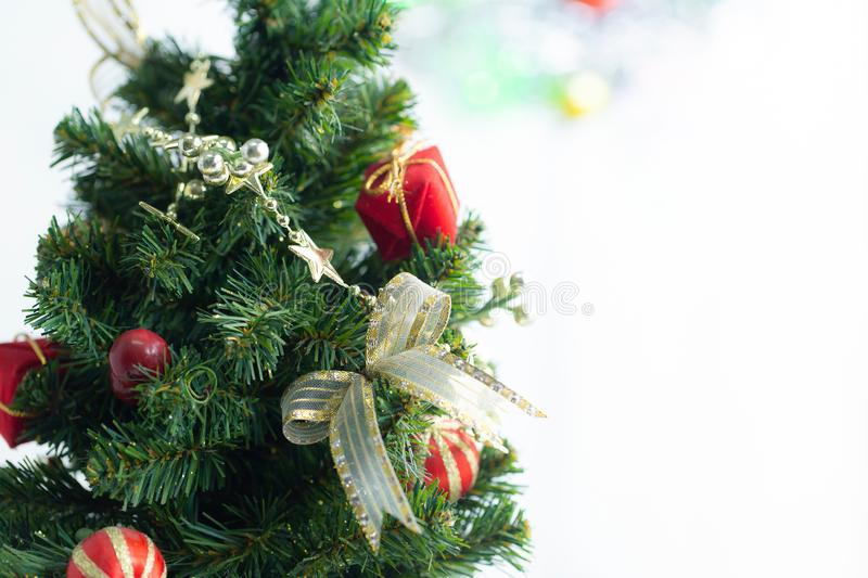 Composition with Christmas decorations fir tree on white background stock image