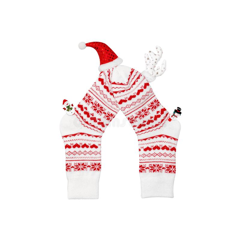 Composition of Christmas white wool socks, deer horns, hat and snowmen on a white background. Christmas concept, gifts, party, coz stock images