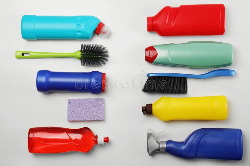 Composition with cleaning supplies on white background royalty free stock photo