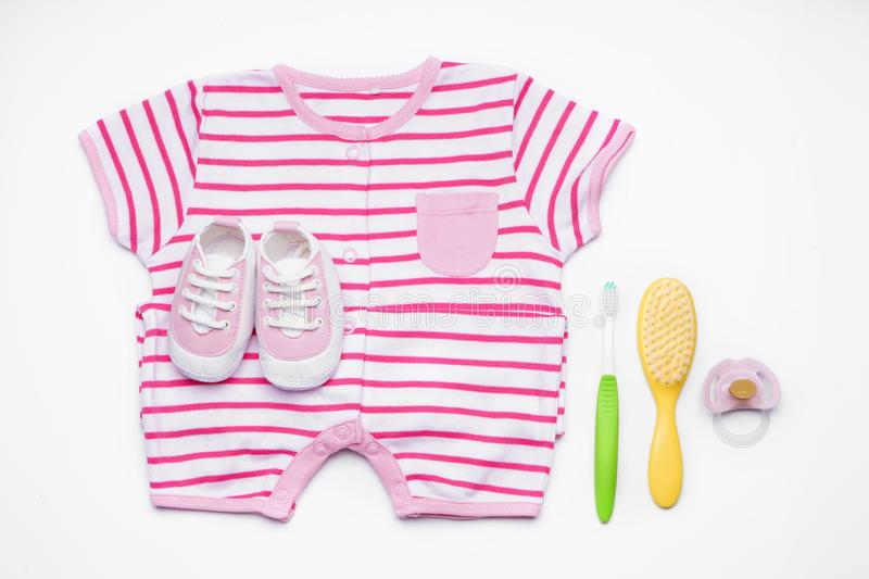Composition with clothes and baby care accessories on white background royalty free stock photo