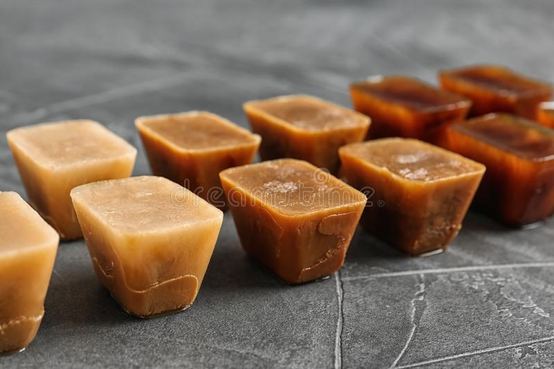 Composition with coffee ice cubes on grey table royalty free stock photography