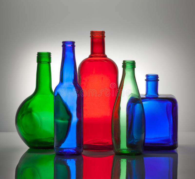 Composition from color glass bottles stock photo