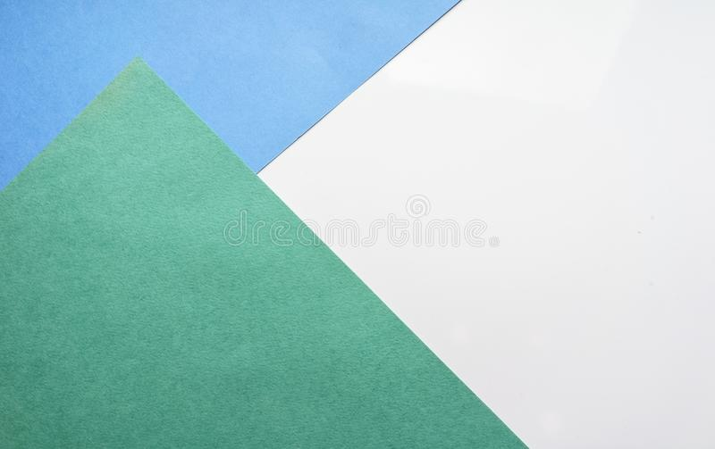 The composition of the colored sheets of paper. Geometric background. Bright typographic design Top view, close-up. The composition of the colored sheets of royalty free illustration