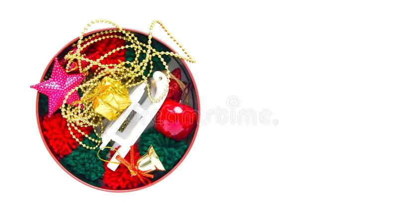 Composition with colorful christmas decorations in roud box on white background. New Year decor. Flat lay, top view, copy space royalty free stock photos