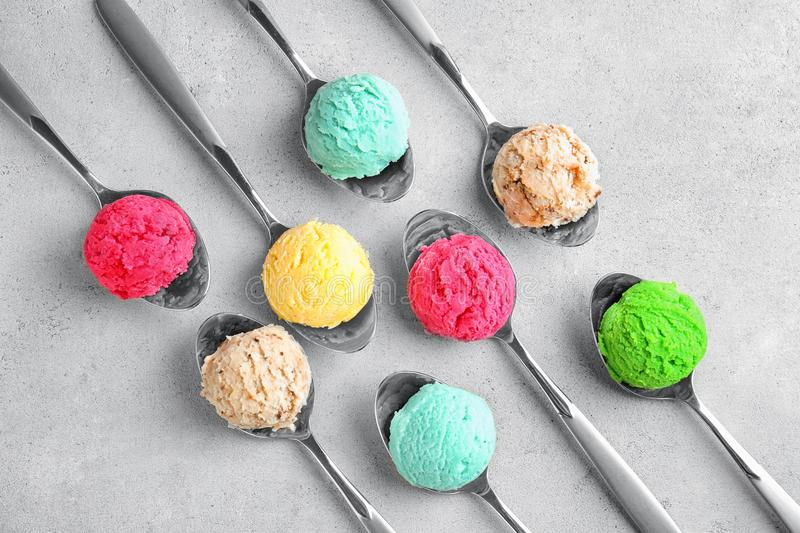 Composition with colorful scoops of ice-cream in spoons royalty free stock photos