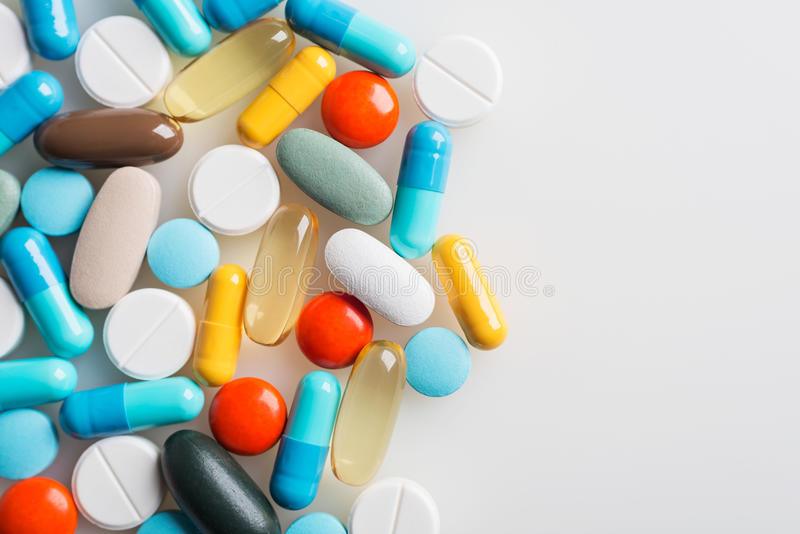 Composition with colourful pills. stock photo