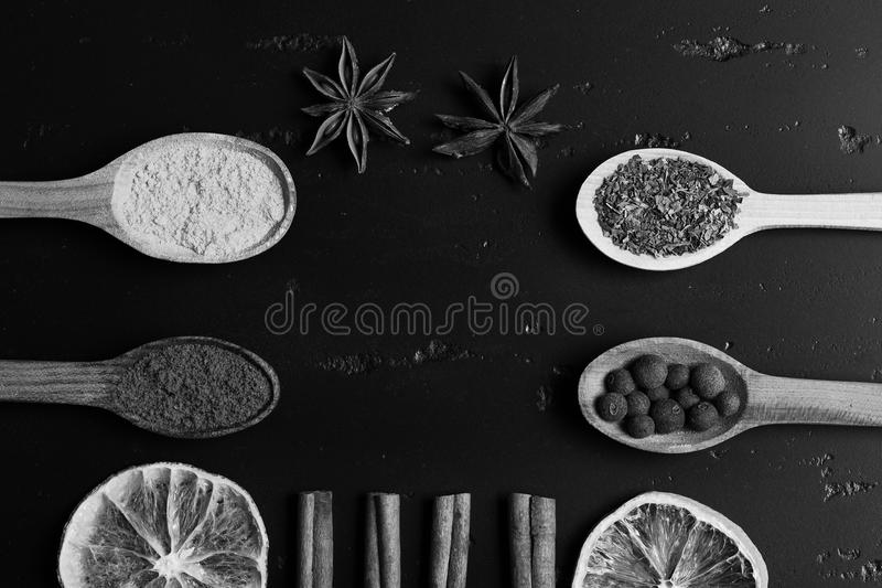 Composition of condiment, top view. Wooden spoons with spices royalty free stock image