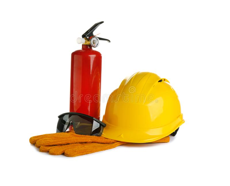 Composition with construction tools and fire extinguisher royalty free stock photo