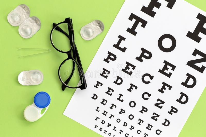 Composition with contact lenses, glasses and accessories on color background. Vision concept. Flat lay royalty free stock photos