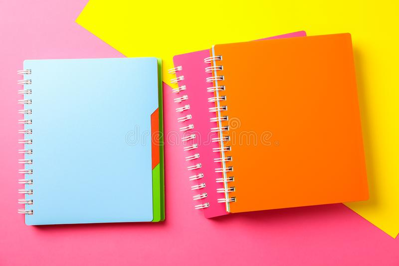 Composition with copybooks on two tone background. Space for text royalty free stock photography