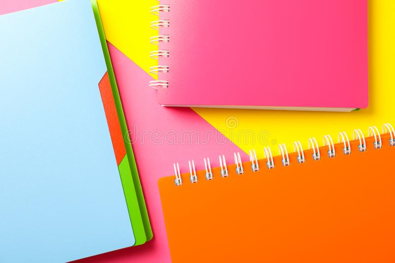 Composition with copybooks on two tone background. Space for text stock image