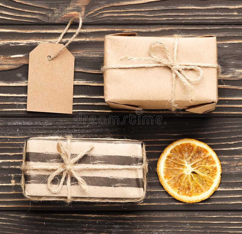 Composition of craft gift boxes on brown wooden background. Christmas royalty free stock photos