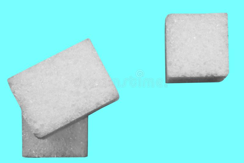 Composition of cubes of white sugar is on a blue background top stock photos